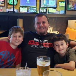 Mike Enjoying Bbq With Sons
