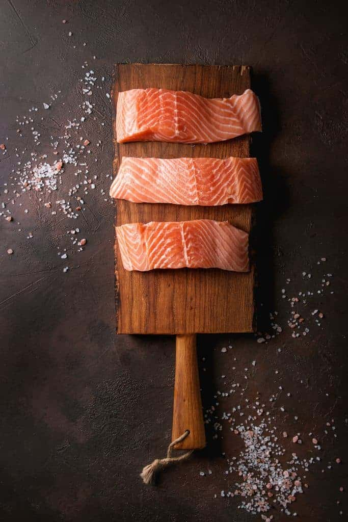 salmon fillets on wood plank